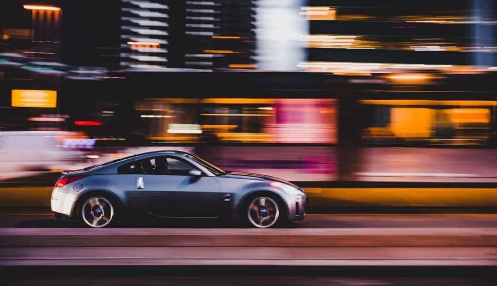 A car going down a city street
